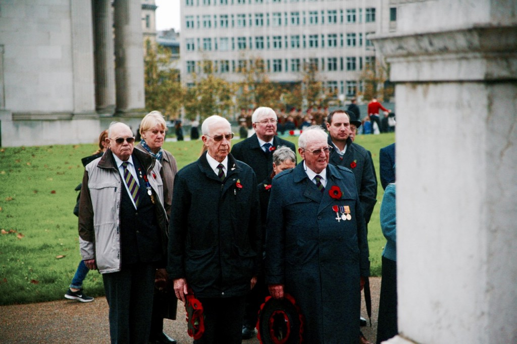 Members of the public pay their respects at the Machine Gun Corps Memorial, Wellington Arch, during a Remembrance Day service.