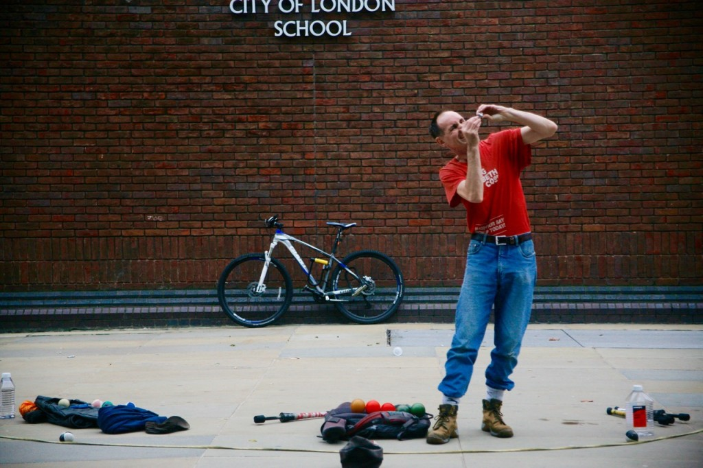 A street performer prepares for show on the stretch to Millennium Bridge.